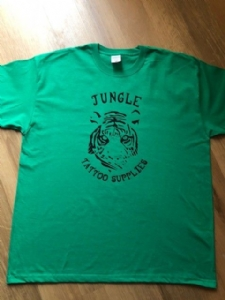 Retro style Jungle Tattoo Supplies t-shirt. Tiger design in green. Design by Nathan Green. Available Mens & Ladies S-XL.
